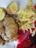 Different Kinds Of Raw Ginger. Raw ginger shown as a whole root, chopped root and grated pieces Stock Photography