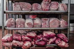Different kinds of raw meat on shelf royalty free stock photos
