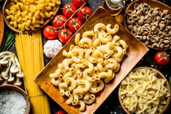 Different kinds of raw paste in bowls with garlic , mushrooms and cherry. Top view royalty free stock images