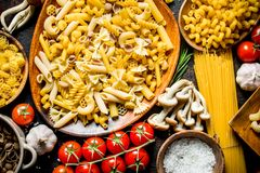 Different kinds of raw paste in bowls with garlic , mushrooms and cherry. Top view royalty free stock photography