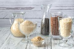 Different kinds of rice on the white background. Different kinds of rice in glassware on the white background Stock Image