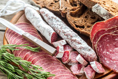 Different kinds of salami with dark-rye bread Royalty Free Stock Photography