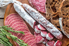 Different kinds of salami with dark-rye bread Royalty Free Stock Image