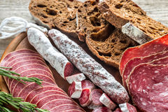 Different kinds of salami with dark-rye bread Stock Image