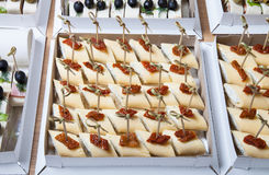 Different kinds of snacks canape on skewers. Selective focus Stock Photography