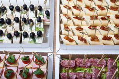 Different kinds of snacks canape on skewers. Selective focus Royalty Free Stock Image