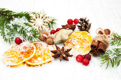 Different kinds of spices,  nuts and dried oranges Stock Photography