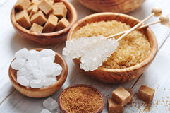 Different kinds of sugar. Brown and white sugar in wooden bowls closeup Royalty Free Stock Image