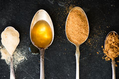Different Kinds of Sugar in the Spoons. Such as coconut sugar, pure cane sugar, icing sugar, agave syrup, dark brown soft sugar, golden caster sugar, demerara Stock Photo