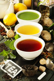 Different kinds of tea in ceramic bowls Stock Image