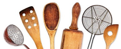 Different kitchen utensils for cooking. Wooden old kitchen utensils for cooking Royalty Free Stock Photo
