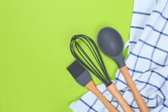 Different kitchenware on a colored background top view. Cooking appliances stock photo