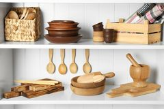 Different kitchenware on shelves. Different empty kitchenware on shelves Royalty Free Stock Image