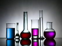 Different lab bottles filled with colored substances Stock Photography