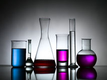 Different lab bottles filled with colored substances Royalty Free Stock Image