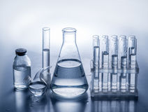 Different laboratory beakers and glassware. Royalty Free Stock Images