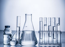 Different laboratory beakers and glassware. Royalty Free Stock Photo