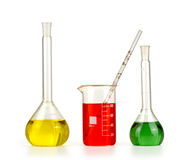 Different laboratory glassware with colored liquid isolated royalty free stock photo