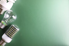 Different lamp on green background Stock Images