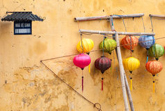 Different lanterns near wall in Vietnam, Asia. Royalty Free Stock Images