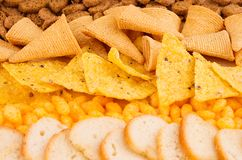 Different latin beer spicy crunchy snacks as background, closeup, pattern. Fast food backdrop Stock Photography