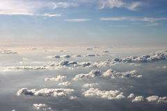 Different layers of clouds. With a pink horizon an puffy white cloud sheep stock image