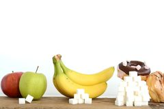 Different level of sugar in food, eating habits concept. Different quantity of sugar in food, eating habits concept Stock Images