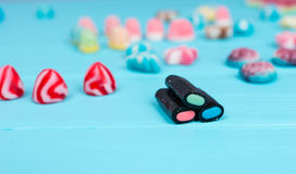 Different licorice and jelly candies on wooden table Royalty Free Stock Photos