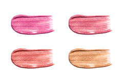 Different Lip Glosses Isolated On White. Smudged Lips Gloss Sample. Stock Photography
