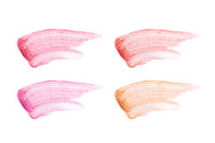 Different lip glosses isolated on white. Smudged lip gloss sample. Stock Photography