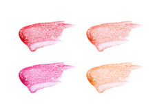 Different lip glosses isolated on white. Smudged lip gloss sample Stock Image