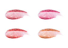 Different lip glosses isolated on white. Smudged lip gloss sample. Stock Image