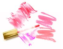 Different lip glosses  on white. Royalty Free Stock Image