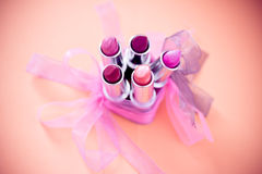 Different lipstick colors with bows and vignette Stock Photography