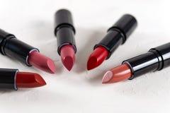 Different lipsticks on white background. Fashion. Professional Makeup and Beauty. Beautiful Make-up concept. Lipgloss. Lipsticks stock image