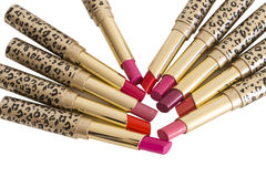 Different lipsticks on white background. Royalty Free Stock Photo