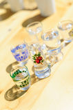 Different liquers in shotglasses Stock Images
