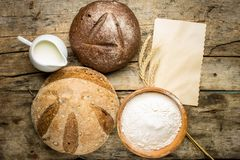 Different loafs of bread with bakery ingredients Royalty Free Stock Images