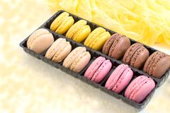 Different macaroon in box royalty free stock images