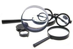 Different magnify glasses. Isolated on the white background Stock Photo