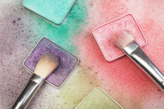 Different make-up palettes and brashes. Different make-up palettes and brushes on white Stock Image