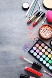 Makeup cosmetics. Different makeup cosmetics on grey wooden table stock photo