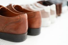 Different male shoes on floor,. Closeup Royalty Free Stock Photos