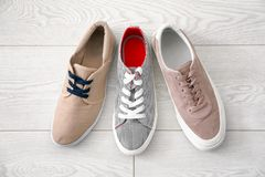 Different male shoes. On wooden floor Royalty Free Stock Photos