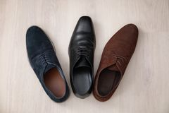 Different male shoes. On wooden floor Stock Photo