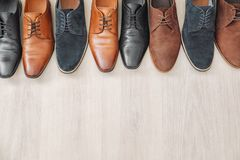 Different male shoes. On wooden floor Royalty Free Stock Image