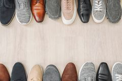 Different male shoes. On wooden floor Stock Photography