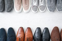 Different male shoes. On wooden floor Royalty Free Stock Images