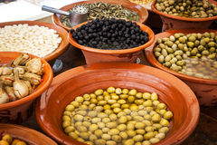 Different marinated olives and local food on spanish street mark Stock Photography