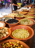 Different marinated olives and local food on spanish street mark Stock Photo